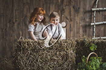 Children among the hay bales.