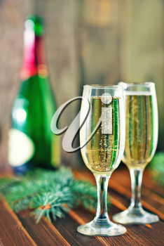 Two Champagne Glasses and Branch of Christmas Tree