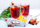 christmas drink with fruits and aroma spice