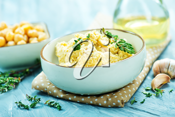 humus in bowl and on a table