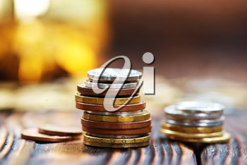 coins on a table, money on wooden table, stock photo