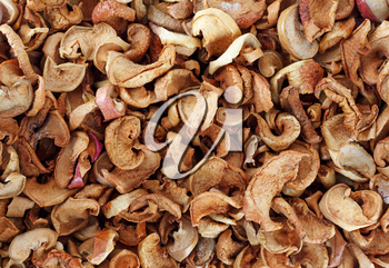 A lot of dried fruit. Dried slices apples background.