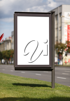 Blank vertical billboard on the street. Clipping path. Shallow depth of field.