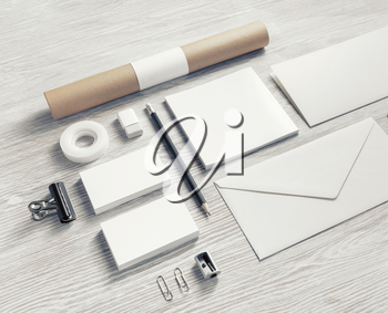 Photo of blank stationery set on light wooden background. Corporate identity mock up for placing your design.