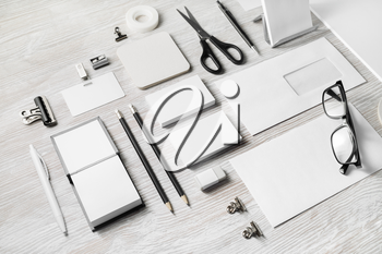 Blank corporate stationery set on light wood table background. Branding mock up. Template for placing your design.