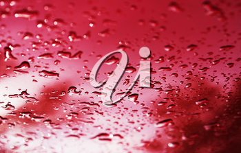 Red water drops after rain bokeh background