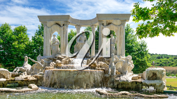 Ravadinovo, Bulgaria – 07.11.2019.  Large antique fountain in the form of a sculptural composition in the castle of Ravadinovo, Bulgaria, on a sunny summer day