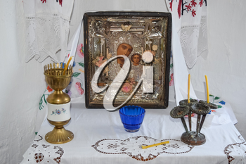 Prayer Area of the house. Mother of God and candles in candlesticks on the table.