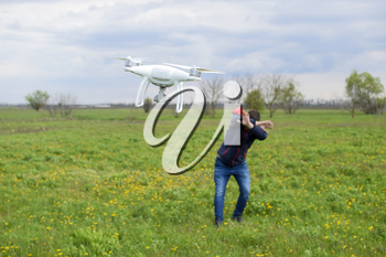 A man hides himself from a collision with a drone. Quadrocopter flies to the person.