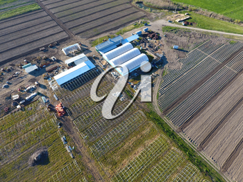 Frameworks of greenhouses, top view. Construction of greenhouses in the field. Agriculture, agrotechnics of closed ground.