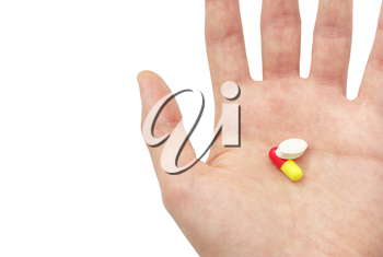 Two pills on the palm. Element of design.