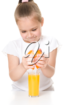Cute girl is drinking orange juice using straw, isolated over white