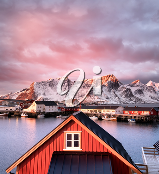 Houses in the Lofoten islands bay during sunrise. Natural landscape during sunrise in the Norway