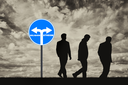 Atheism. Three men Atheists have chosen the direction of atheism near the road sign