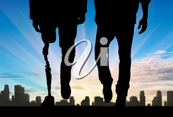 Leg man with prosthetic and normal legs on background city and sunset. Concept disabled person