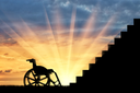 Wheelchair in front of stair sunset. Concept of disability