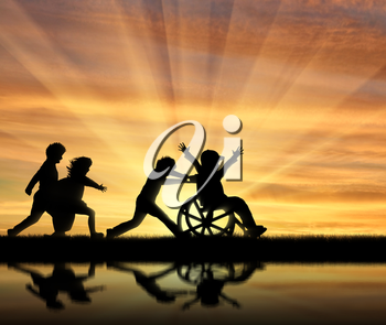 Happy boy in wheelchair playing with children and their reflection in water sunset. Concept happy child disabled