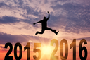 Concept of the new year. A man in a jump between 2015 and 2016 years