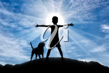 Happy childhood concept. Silhouette of a happy child on top of a hill at sunset with the dog
