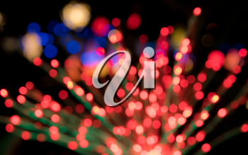 Defocused bokeh of christmas tree lights to be used as abstract background for holiday image