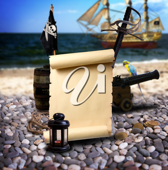 Pirate ambiance with with scroll and space for text, cannon, treasure, lantern, and parrot on the bank of an empty pebble beach. In the background is pirate schooner.