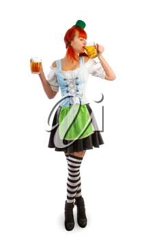 red irish waitress drinks beer from a glass goblet holding a second goblet in hand