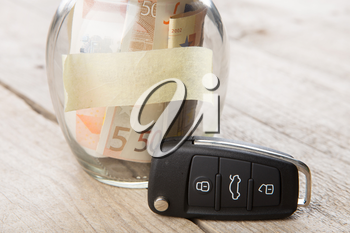 Car finance concept - money glass with sticker, car key