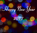 Card with Happy New Year 2017 writing on multicolor light bokeh. New Year 2017 card.
