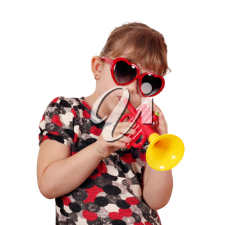 little girl with sunglasses play trumpet