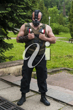 Lviv, Ukraine - May 23,2015: Man  dressed in the style of the strongman performs  at the festival cosplay Anicon in Lviv May 23.2015