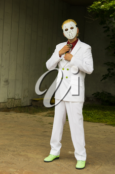 Lviv, Ukraine - May 23.2015:Cosplayer boy  posing in a white suit and a hockey mask  , photo taken at cosplayers meeting outdoor in Lviv city.May 23.2015