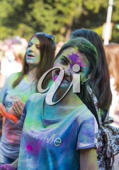 Lviv, Ukraine - August 30, 2015: Girl have fun during the festival of color in a city park in Lviv.