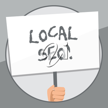Word writing text Local Seo. Business photo showcasing incredibly effective way to market your near business online Hand Holding Blank White Placard Supported by Handle for Social Awareness