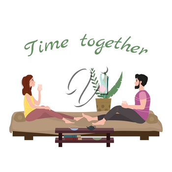 Cute loving couple sitting on bed drinking tea or drinks and eating together at home